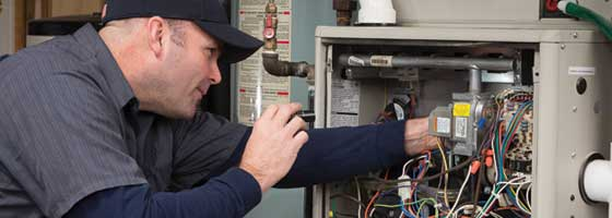 Contractor Fixing Furnace